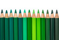 Row with Blue and Green Colored Crayons Royalty Free Stock Photo