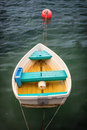 Row boat fiberglass dory moored in quiet water Royalty Free Stock Photography