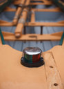 Row boat navigation light closeup view of a small with seats and oars in background Royalty Free Stock Images