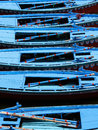 Row Boats Floating on the Ganges River in Varanasi, India Royalty Free Stock Photo