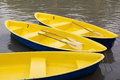 Row boats yellow in the lagoon Stock Images