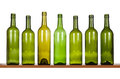 Row of bottles different size wine on a shelf isolated on white background Royalty Free Stock Photo