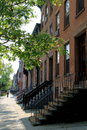 Row of brick homes with solitary man walking away Royalty Free Stock Photo