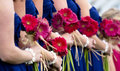 Row Of Bridesmaids And Flowers