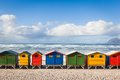 Row of brightly colored huts in muizenberg beach muizenberg cape town south africa Stock Images