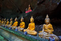 A row of buddha statues in the cave petchburi province thailand Royalty Free Stock Image