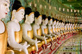 Row of buddha statues with golden robe Royalty Free Stock Photography