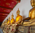 Row of buddha statues in Wat Po temple Royalty Free Stock Photography