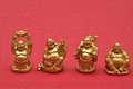 Row of Buddhas Figurines Royalty Free Stock Photo