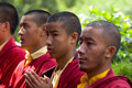 A row of Buddhist monks praying Stock Photos