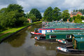 Row of canal boats large number moored up Stock Photo
