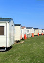 Row of caravans in trailer park scenic view with blue sky background Royalty Free Stock Image