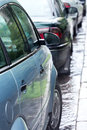 Row of cars parked on flooded street Stock Images