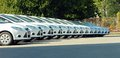 Row of cars white are lined up in the parking lot in one line Stock Photography