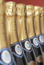 Row of champagne bottles close up selective focus Stock Photo