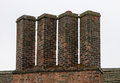 A Row of Chimneys on Tudor building Royalty Free Stock Photo
