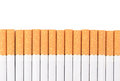 Row of cigarettes on white background Royalty Free Stock Photo