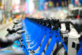 Row of city bikes for rent at docking stations in new york usa Stock Image