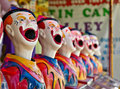 Row of clowns at fete or fair Royalty Free Stock Photo
