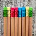 Row of color pencils on grey background studio Stock Photo