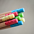 Row of color pencils on grey background studio Royalty Free Stock Image