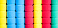 Row of color pencils on grey background studio Royalty Free Stock Photo