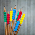 Row of color pencils on grey background studio Stock Photography