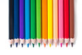 Row of colored pencils cloistered on white background Royalty Free Stock Photography