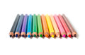 Row of colored pencils cloistered on white background Royalty Free Stock Images