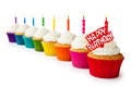 Row colorful birthday cupcakes Royalty Free Stock Photo