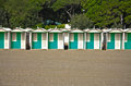 Row of colourful beach huts on a sandy beach Royalty Free Stock Photo
