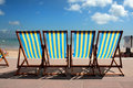 Row of colourful deckchairs on Weymouth beach Royalty Free Stock Image
