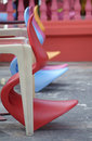 Row of colourful plastic chairs Royalty Free Stock Photo