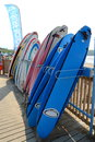 A row of colourful surfboards brightly coloured Royalty Free Stock Photo