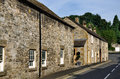 Row of cottages in ashford on the water traditional stone at derbyshire peak district national park Royalty Free Stock Photo