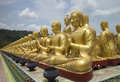 Row of disciple statues surrounding Big buddha statue Royalty Free Stock Photo