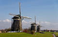 Row of Dutch wind mills Royalty Free Stock Images