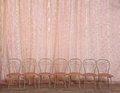 A row of empty chairs against a theater curtain. in the theater. Royalty Free Stock Photo