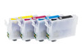 Row of empty refillable cartridges for colour inkjet printer isolated on white background Stock Photos