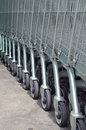 Row of empty shopping carts in big supermarket cart the Royalty Free Stock Image