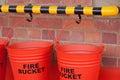 ROW OF FIRE BUCKETS Royalty Free Stock Photo