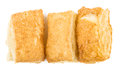 Row of flaky biscuits isolated on white background Royalty Free Stock Photo