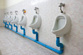 Row of four urinals in the toilet Stock Photography