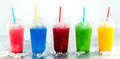 Row of Frozen Fruit Slushies in Plastic Cups Royalty Free Stock Photo