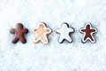 Row of gingerbread men in snow Royalty Free Stock Photo