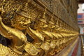 Row of golden Buddha statues Stock Photography