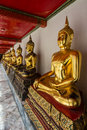 Row of  Golden  Buddhas Royalty Free Stock Photo