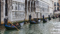 Row of gondolas venice italy march a with tourists sailing on the grand canal in venice during the carnival days Royalty Free Stock Photos