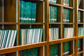 Row of green thesis in the large bookshelf in chul chulalongkorn university thailand it is full master degree knowledge Stock Photography