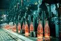 Row of hot orange glass bottles Royalty Free Stock Photo